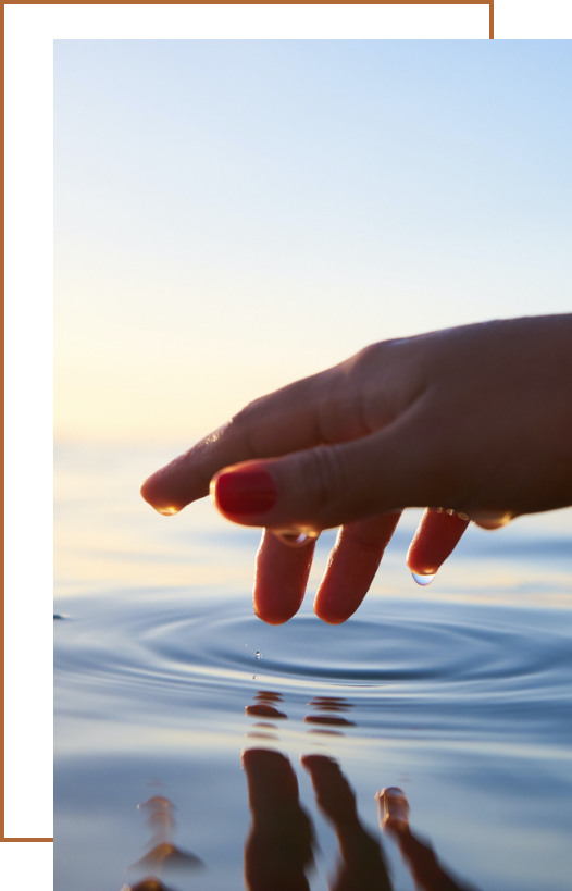 hand touching a ripple of water